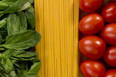 Italian flag with food ingridients. Italian flag made of basil, pasta and tomatoes Royalty Free Stock Photography