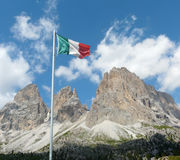 Italian flag in front of Dolomite mountains Stock Photography