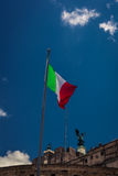 Italian flag on the front of the Sculpture of angel Stock Photography