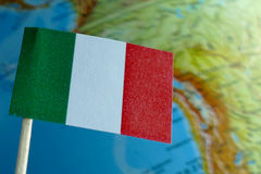 Italian flag with a globe map as a background Royalty Free Stock Photos
