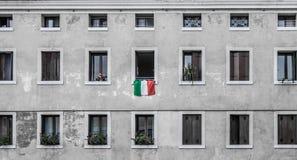 Italian flag on a gray wall winth windows royalty free stock photos