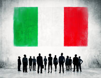 Italian flag and a group of business people Stock Image