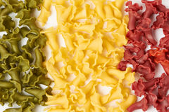 Italian flag made from color pasta. In shape of lily Royalty Free Stock Photos