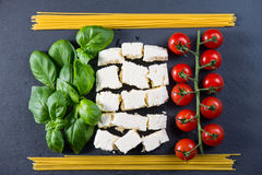 Italian flag made from fresh food. Italian flag made from fresh tipical food on black background royalty free stock photography