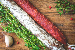 Italian flag made up of red and white salami, green sprigs thyme Stock Photos