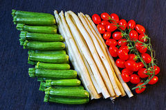 Italian flag made of vegetables. Italian flag made of green zucchini, white asparagus and red tomatoes royalty free stock photo
