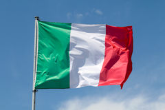 Italian flag. On mast in the wind royalty free stock photography