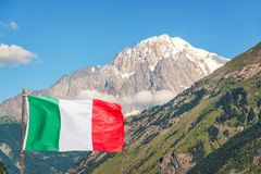Italian flag, Monte Bianco Mont Blanc in the background view from Aosta Valley Italy. Italian flag, Monte Bianco Mont Blanc in the background view from Aosta Stock Photos