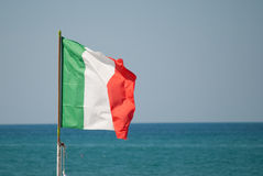 Italian flag over the sea Stock Photos