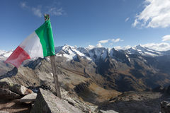 Italian flag over a top in the Italian Alps Royalty Free Stock Image