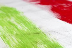 Italian flag painted with  brush strokes on white background. Italy. Italian flag painted with three vertical brush strokes on white background royalty free stock photography
