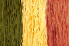 Italian flag pasta. Dried spaghetti in Italian flag colors Royalty Free Stock Photo