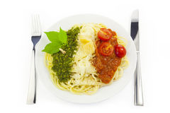 Italian flag - pasta with green pesto... Italian flag - pasta with green pesto, white parmesan and red tomatoes / isolated on white Stock Image