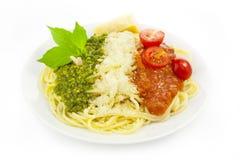 Italian flag - pasta with green pesto... Italian flag - pasta with green pesto, white parmesan and red tomatoes / isolated on white Stock Photos
