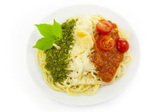 Italian flag - pasta with green, white, and red. Italian flag - pasta with green pesto, white parmesan and red tomatoes / isolated on white Stock Photos