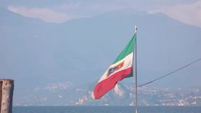 Italian flag on scenic background. stock footage
