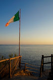 Italian flag at sunset. An Italian flag flaps in the breeze against a beautiful sunset Stock Images
