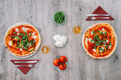 Italian flag. Tasty pizza on a rustic table and ingredients composing the italian flag, mediterranean eating concept royalty free stock images