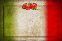 Italian flag with tomatoes and frame. Traditional Italian flag with tomatoes and basil on blank frame stock image