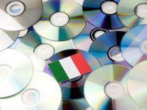 Italian flag on top of CD and DVD pile isolated on white Royalty Free Stock Photo