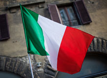 Italian flag Venice. Italian flag and building blurred in the background stock photography