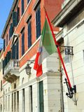 Italian Nautical Flag, Venice. Italian Nautical Flag flying on Venice building facade, Italy royalty free stock photography