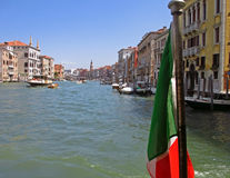 Italian flag and Venice Grand canal on background Royalty Free Stock Photo