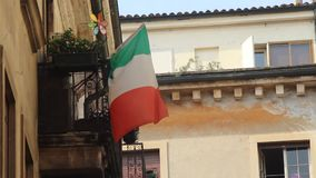 Italian Flag Waving on Balcony of House stock footage