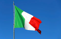 Italian flag waving in the sky without clouds Royalty Free Stock Photography