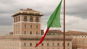 Italian flag waving in the wind on the National Monument in Rome. Videoclip stock video
