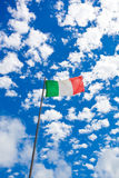 Italian flag waving in the wind over the blue sky Stock Photography