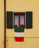 Italian Flag on Yellow Building Stock Photography