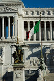 Italian Flaga with Altare della Patria on the back. One of the major landmarks in Italian capital Royalty Free Stock Photo