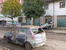 Italian floods aftermath, upturned car write-off. Destroyed vehicles. Flash floods devastated parts of Northern Tuscany, Lunigiana and Liguria on Tuesday 25th royalty free stock image