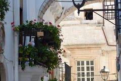 Italian flowered balconies Stock Images