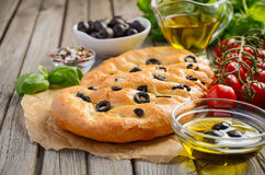 Italian focaccia bread with olives and rosemary Stock Photos