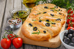 Italian focaccia bread with olives and rosemary Royalty Free Stock Photos
