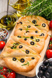 Italian focaccia bread with olives and rosemary Stock Photography