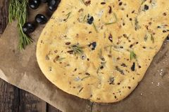 Italian focaccia bread with olives and rosemary stock images