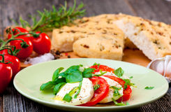 Italian focaccia and caprese salad Royalty Free Stock Photography