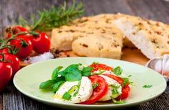 Italian focaccia and caprese salad Royalty Free Stock Photography