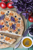Italian focaccia with tomatoes, black olives and basil Royalty Free Stock Photo
