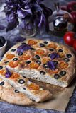 Italian focaccia with tomatoes, black olives and basil Stock Photo