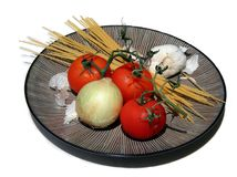 Italian Food a. Uncooked food on a plate royalty free stock photography