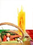 Italian food. On Italian flag sheet isolated on a white background Royalty Free Stock Photo