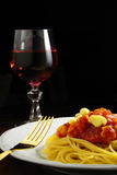 Italian Food. Delicious spaghetti with red sauce and mushrooms and glass of red wine meal Stock Image