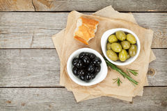 Italian food appetizer of olives, bread and herbs Royalty Free Stock Images