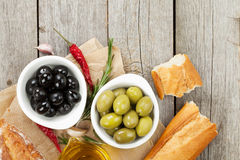 Italian food appetizer of olives, bread and spices Stock Image