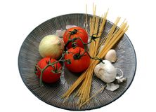 Italian Food b. Un-cooked food on a plate royalty free stock image