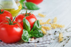 Italian food background, with tomatoes, basil, pasta, olive oil,. Peppercorns, chili pepper and thyme. Food concept Royalty Free Stock Photography